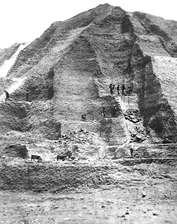 "Workers in the 1860s excavate a ""mountain"" of guano"